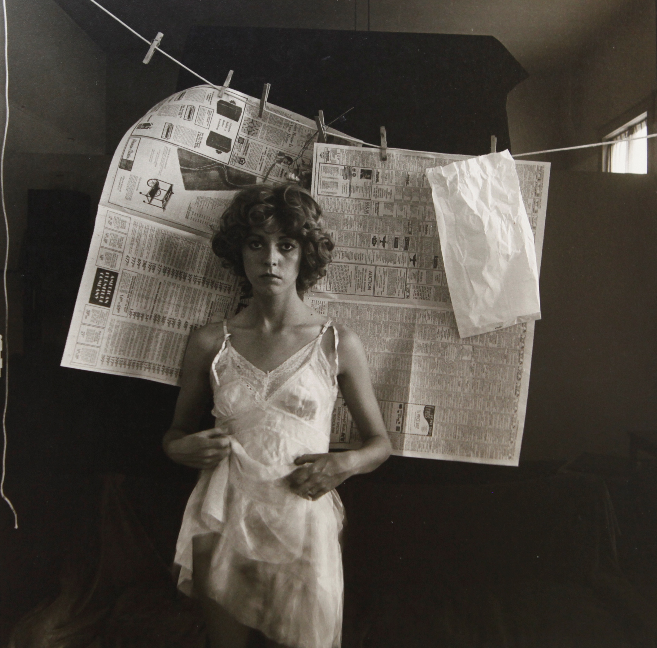 Woman in Front of Newspapers