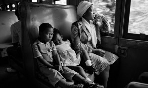 South African Family Traveling on a Train by David Turnley
